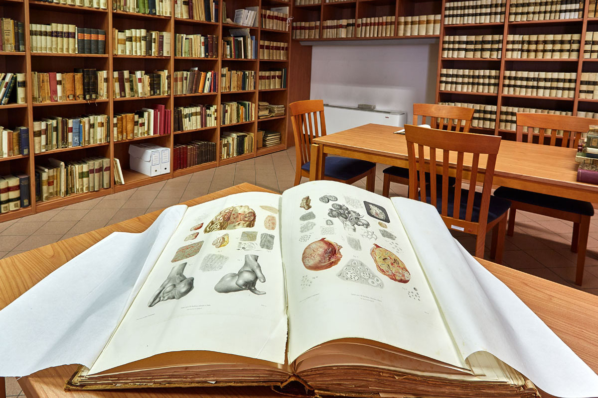 Library Reading Room showing open pages of one of the 19th century medical books